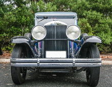 Front Grill And Round Headlights Of Restored Vintage Gangster Car.