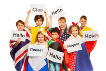 Kids Holding Greeting Signs In Different Languages