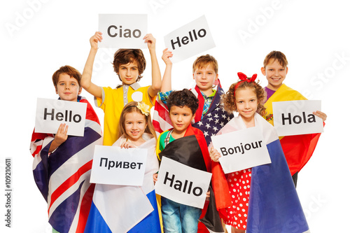 Fotografie, Obraz  Kids holding greeting signs in different languages