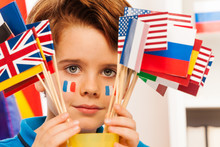 French Boy With Flag On Cheeks Hide Behind Banners
