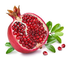 Pomegranate Fruit With Green Leaves.