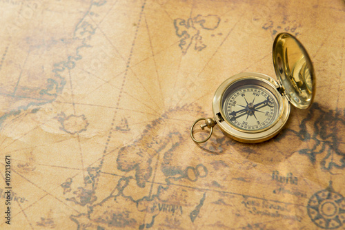 old compass on vintage map Wallpaper Mural