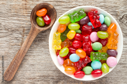 Poster Confiserie Spoon and bowl of various candies