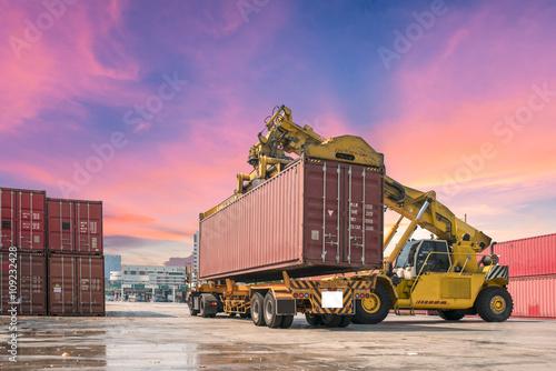 Fotografie, Obraz  forklift handling the container box packed up transport trucks.