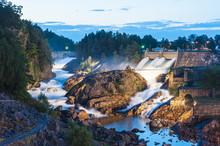 Dam On River At Dusk