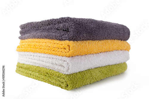 Fotografia  Four colorful towels isolated on white background