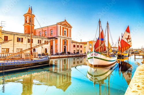 Church and ancient sailboats on Canal Port