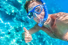 Snorkeling Man Underwater Giving Thumbs Up Ok Signal Wearing Snorkel And Mask Having Fun On Beach Summer Holidays Vacation Enjoying Recreational Leisure Time Swimming In The Sea.