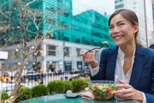 Business Woman Eating Salad On...