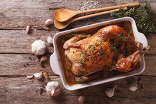 French Food: Chicken With 40 Cloves Of Garlic In The Dish For Baking Close-up. Horizontal Top View