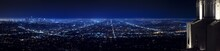 Los Angeles City Skyline Panorama At Night With Griffith Observatory On The Right