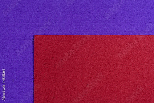 Fotografering  Eva foam ethylene vinyl acetate red surface on purple sponge plush background