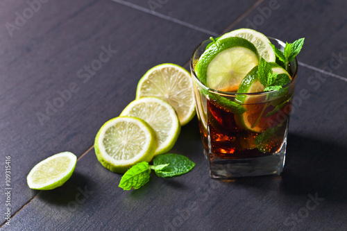 cocktail Cuba libre with lime and peppermint leaves Wallpaper Mural
