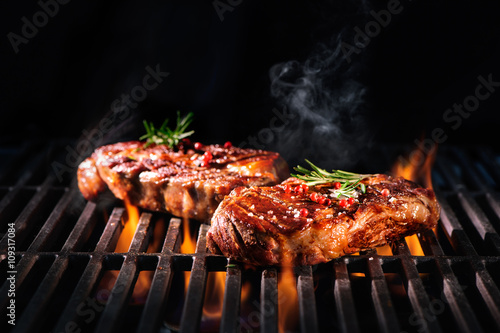 Aluminium Prints Steakhouse Beef steaks on the grill