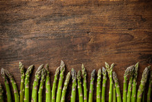 Fresh Asparagus On Wooden Back...