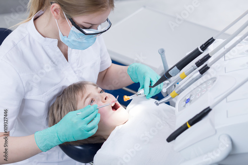 Photo  Brave little patient suffering from caries