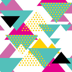 Seamless geometric pattern with magenta, green, yellow triangles in pop art, retro 80s style. With dot on white background.