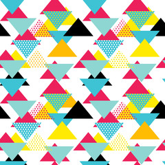 Fototapeta Abstrakcja Seamless geometric pattern with magenta, blue, yellow triangles in pop art, retro 80s style. With lines, zigzag, dot on white background.