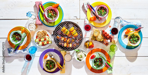 Tuinposter Grill / Barbecue Colorful picnic table with vegan cuisine