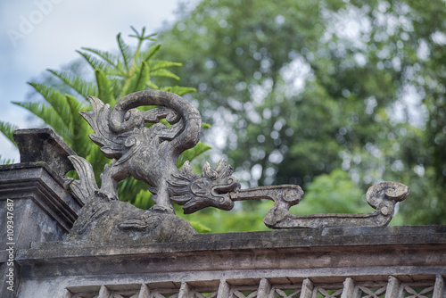 Photo Stands Bonsai Dragon on oriental the old temple roof in Vietnam.