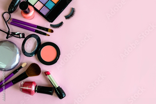 Fotografie, Obraz  make up with cosmetics and brushes isolated on pink background