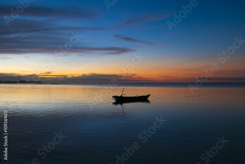 Tuinposter Sunset with fisher boat and still water on Gili Air Island, Indo