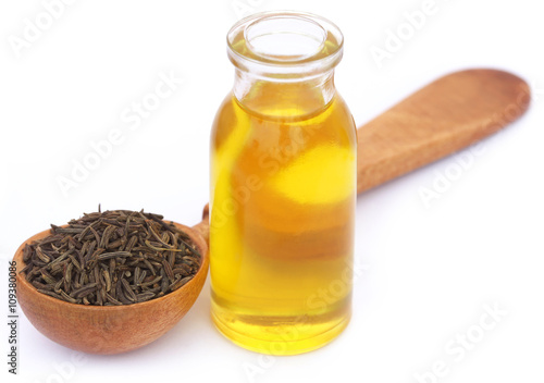 Caraway seeds with essential oil in glass bottle - Buy this