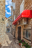 Fototapeta Uliczki - Picturesque narrow street in Old Town in Budva, Montenegro.