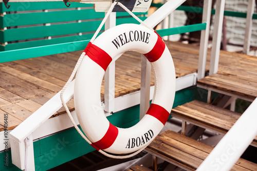 Fotografie, Obraz  Lifebuoy decoration on a wooden aboard
