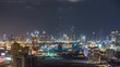 Scenic Dubai downtown skyline timelapse at night. Rooftop view of Sheikh Zayed road with numerous illuminated towers.