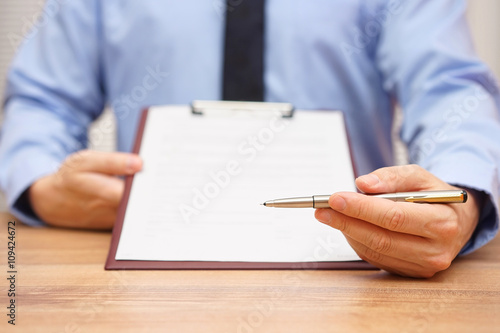 manager is offering a pen to sign a document or agreement Canvas Print