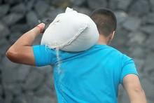Mud Race Runners,young Man Carrying Tear Sandbag