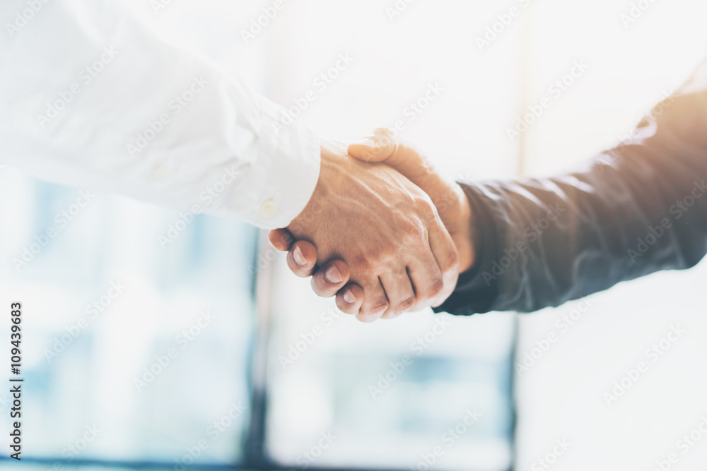 Fototapeta Business partnership meeting. Picture businessmans handshake. Successful businessmen handshaking after good deal. Horizontal, blurred background