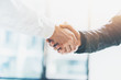 Leinwandbild Motiv Business partnership meeting. Picture businessmans handshake. Successful businessmen handshaking after good deal. Horizontal, blurred background