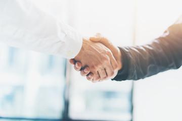 Naklejka Business partnership meeting. Picture businessmans handshake. Successful businessmen handshaking after good deal. Horizontal, blurred background