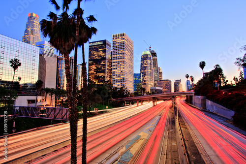Foto op Plexiglas Los Angeles City of Los Angeles Downtown at Sunset With Light Trails