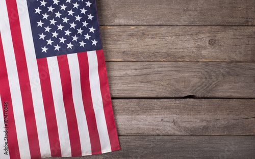 Fototapeta United States Flag on Wooden Background with Copy Space