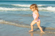 cute little girl play with water on beach