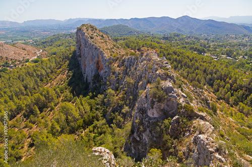Fotografie, Obraz  Rugged terrain near Spanish town Xativa in Valencia province