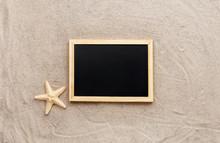 Blank Small Blackboard On Beach Sand With Starfish