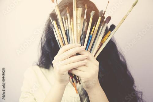 Fototapeta woman hand painting brushes obraz na płótnie