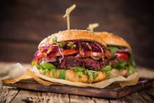 Tasty Vegetarian Beet Burgers On Wooden Table.