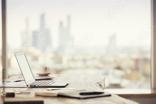 Office desktop on city background