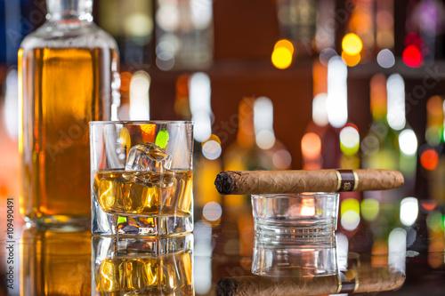 Fényképezés  Whiskey drinks on bar counter.