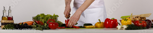 Keuken foto achterwand Koken cooking diet meal mixed salad. hands cut vegetables