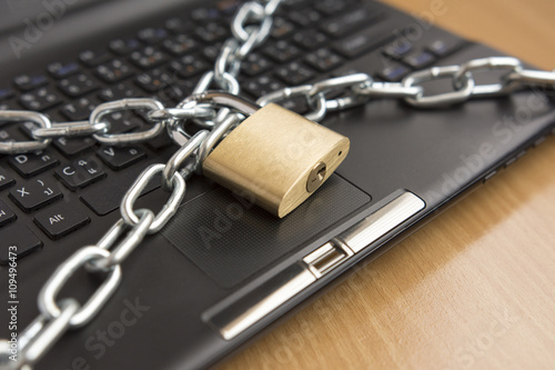 padlock with chain lock on computer - computer security concept - selective focus #109496473