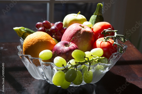 Bowl of Fruit and Vegetables on Table with Sun Light