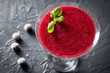 red smoothie with frozen berries, selective focus, top view. detox koncept