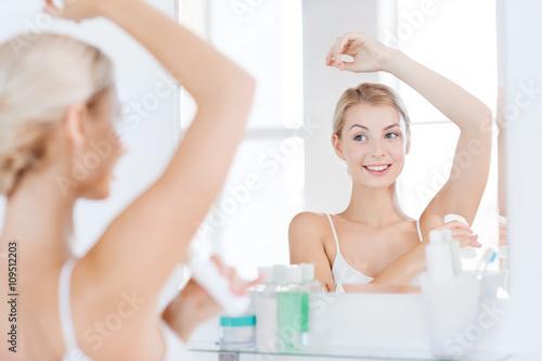 woman with antiperspirant deodorant at bathroom Wallpaper Mural