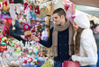 Couple choosing Christmas decoration